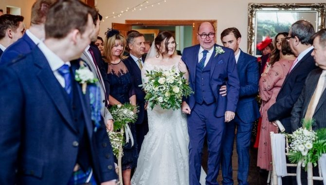 Father walks bride down aisle 10 days after becoming paralysed by brain tumour